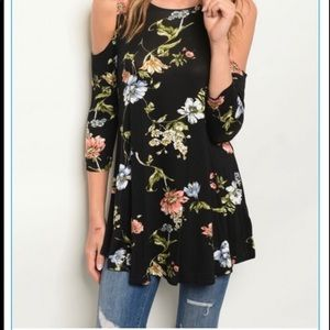 Black flowered  off the shoulder blouse .